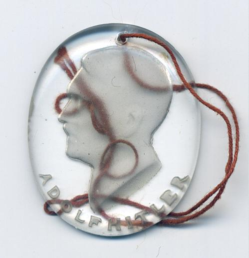 A Winter Help Medallion showing Adolf Hitler's head at WWW.Thirdreichmedals.com