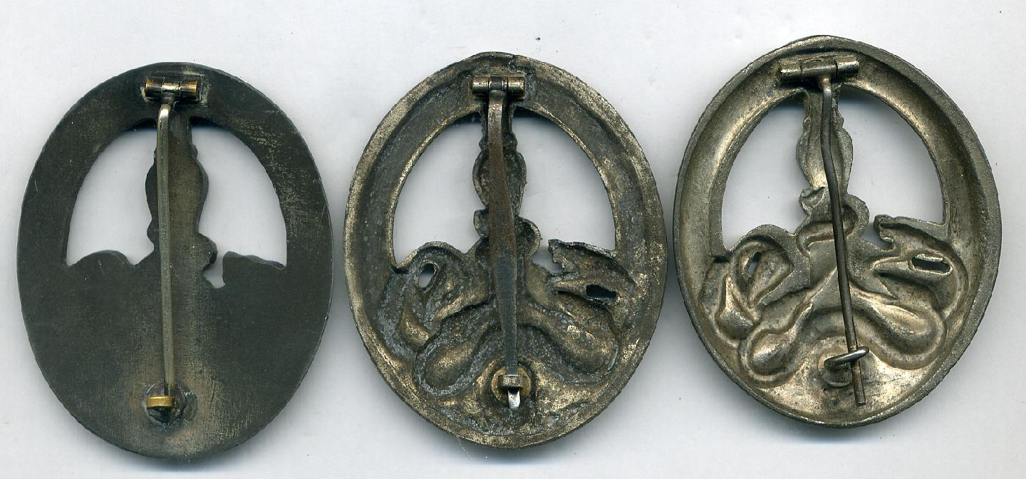 Three Anti-Partisan Badges.